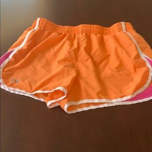 Under Armour orange and pink athletic shorts med